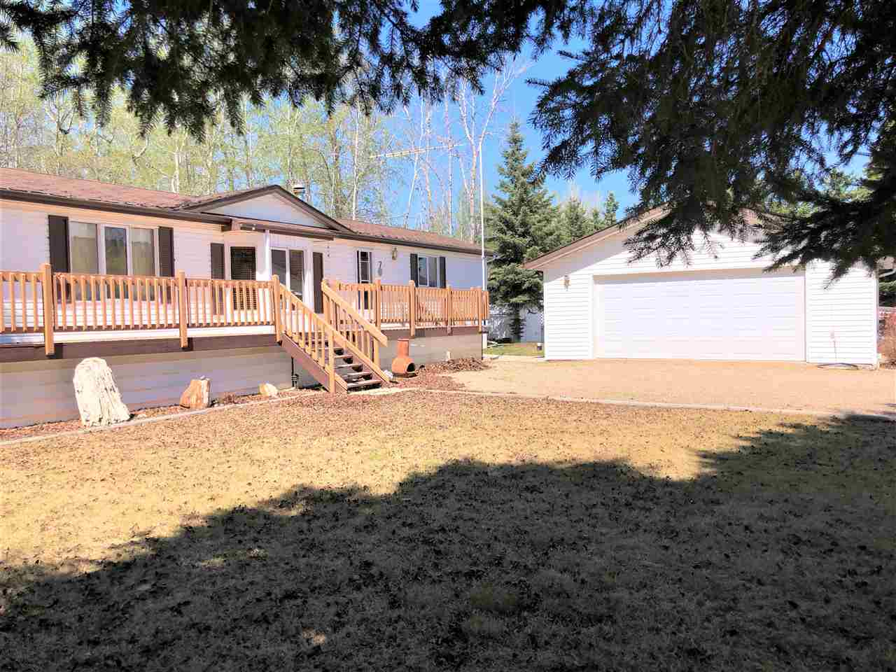 If you are a golf enthusiast or simply looking to escape to the country this is a great home or weekend retreat. Just 20 minutes east of Drayton Valley or 1 hour west of Leduc in the gated community on the Golf Course. The home has an open concept, large kitchen & living room. The master bedroom & ensuite is at opposite ends of the other 2 bedrooms & bathroom. It's a very bright kitchen with a sky light & window over the sink looking out on the treed back yard. The living room has a nice bay window bringing in the afternoon sun. Or you can sit on the 48x10 deck to enjoy the outdoors. The laundry/mud room provides access to the back deck & has 2 double closets for storage as well as cabinets above the washer/dryer. Property sits on .4 acres. The lot & home shows pride of ownership. The oversized 24x28 garage is heated & fully finished inside. The mature spruce offers privacy to the yard & home. The Club house has restaurant & lounge or enjoy the Condo club house for the pot lucks, gatherings, games, etc.