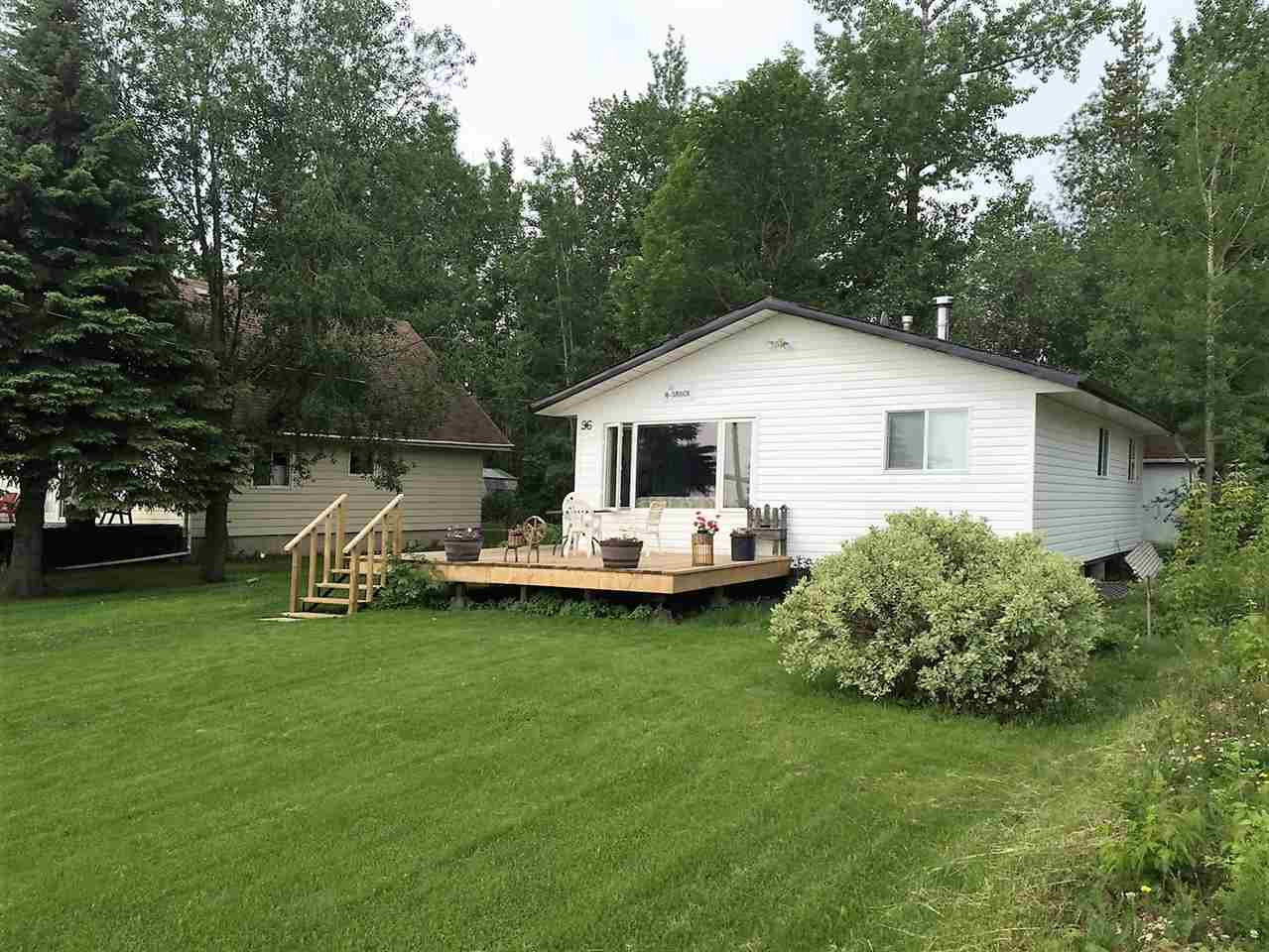 #96 Grandview. Great location & panoramic open view of Pigeon Lake. Seasonal 3 bdrm cabin appr. 864 sqft with open plan, w/b stove, 4 pc bath, newer front deck and private back yard with firepit! Good size lot 60'x150' right across from the boat launch to put your dock or boat lift out front & kids will enjoy the playground & gazebo. Services include power, natural gas, drilled well and holding tank. Affordable price for an ideal retreat.