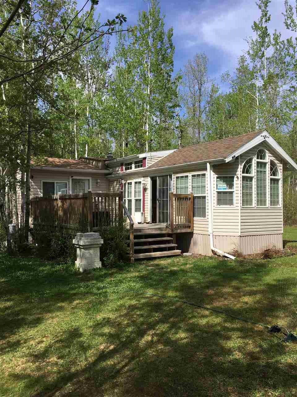 Escape to a peaceful beautifully landscaped and pristine 2.5 acres at Mulhurst Bay, Pigeon Lake. Enjoy the 3 season 2008 park Model with an addition for guests. The lot is serviced with a drilled well, 285 ft. deep, power, propane heat, 2000 gallon septic holding tank. There is natural gas onto the property as well. The yard features 2 storage sheds, a Sea-can, and a bunk house. The home has a large deck to enjoy the landscaped yard. Total privacy from neighbors, 1 minute to Mulhurst Bay, groceries, golf, boat launch and public beach.