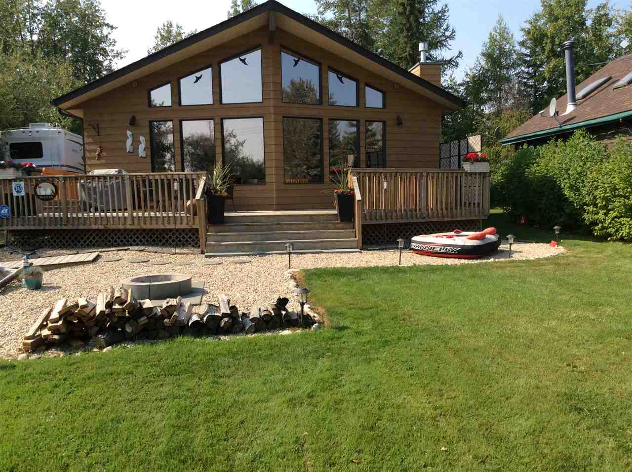 Dreaming of Lake Access and Unobstructed Lake Views without Waterfront Cost? Here You Go!! 343 Crystal Springs tucked into a cul-de-sac offers that and more! Refreshing, Calming Tones, New Baseboard, Casings & some Lighting. Impeccably maintained 3 bdrm, 2 bath, bungalow showcases Vaulted Cedar Lined Ceiling, Glazed Rake Head Windows, Abundant Lake Facing Windows with Pigeon Lake views from the Open Concept Kitchen/Gathering room, Gas Fireplace, Ideally located Laundry Area and Skylights providing Natural Lighting, Massive Wrap Around Deck, Storage shed, Guest House and last but not LEAST...22x32 Garage! New Fence, well pump, Reverse Osmosis, Rear deck ALL Ready and Waiting for your Family!!!! BEST OF  BOTH WORLDS with Lake Access, Park across from your Front Fire Pit or back Private Deck! Work is Done!!! Congratulations You have now Discovered a Property that offers it ALL! Bring the Family, the Watercraft and starting building your memories THIS summer! Wastewater update information in Private Remarks.