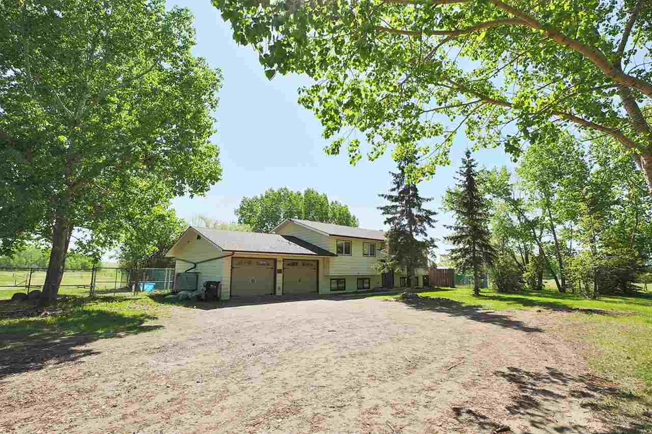 Hard to find horse property on 12 acres with your very own pond is now available for your consideration. You will love the very private setting of this 1100 sq ft bi-level home offering 6 bedrooms. Freshly painted, the main floor offers the kitchen with new counter tops, glass tile back splash & newer appliances, large living room, 3 bedrooms and an updated 4 pce bath. The 2 pce ensuite is currently a 1 pce used as additional closet space & can be easily converted back. The large back deck 41'x10' runs the length of the home and is great for entertaining. The walk-out basement is finished with 3 bedrooms, a family room, 3 pce bath & laundry area. The double attached garage is oversized 23'x24', heated, insulated and includes built-in shelving. The property is fenced & cross fenced with a pole shed 20'x23' with 3 stalls, a few storage sheds and a watering dugout all for your livestock.