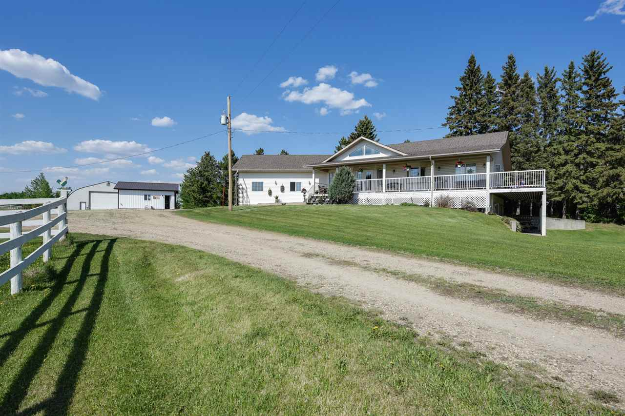 Welcome to the FAMILY FARM. Long time owners are selling 78 acres with TWO RESIDENCES on the property and all of the out buildings you could need! A MACHINE SHOP, MILK BARN, CALF BARN, WORKSHOP, HAY SHED & more. FENCED AND CROSS FENCED WITH APPROXIMATELY 55 ACRES OF CULTIVATED AND THE BALANCE IN PASTURE. The seller has the adjacent NORTH 1/2 separately titled 78 acres that could be sold with this property. Previously a full cattle operation, the pasture & crop are currently leased. The main home was built by SHER-BILT CONSTRUCTION and offers a fully developed WALKOUT BUNGALOW with 4 beds, 3.5 baths, VAULTED CEILINGS & HARDWOOD FLOORING. A WRAP VERANDAH with AMAZING VIEWS & a CONCRETE PATIO leads to the yard & garden. Recent UPGRADES include LAMINATE FLOORS in the  LOWER LEVEL & STAINLESS KITCHEN APPLIANCES! FEATURING PVC windows, large laundry area, IN FLOOR HEAT IN THE ATTACHED GARAGE & ENSUITE BATHROOM. The 2ND. RESIDENCE has had same tenant FOR 11 YRS. @ $1800.00/month. Great property! GST may apply.