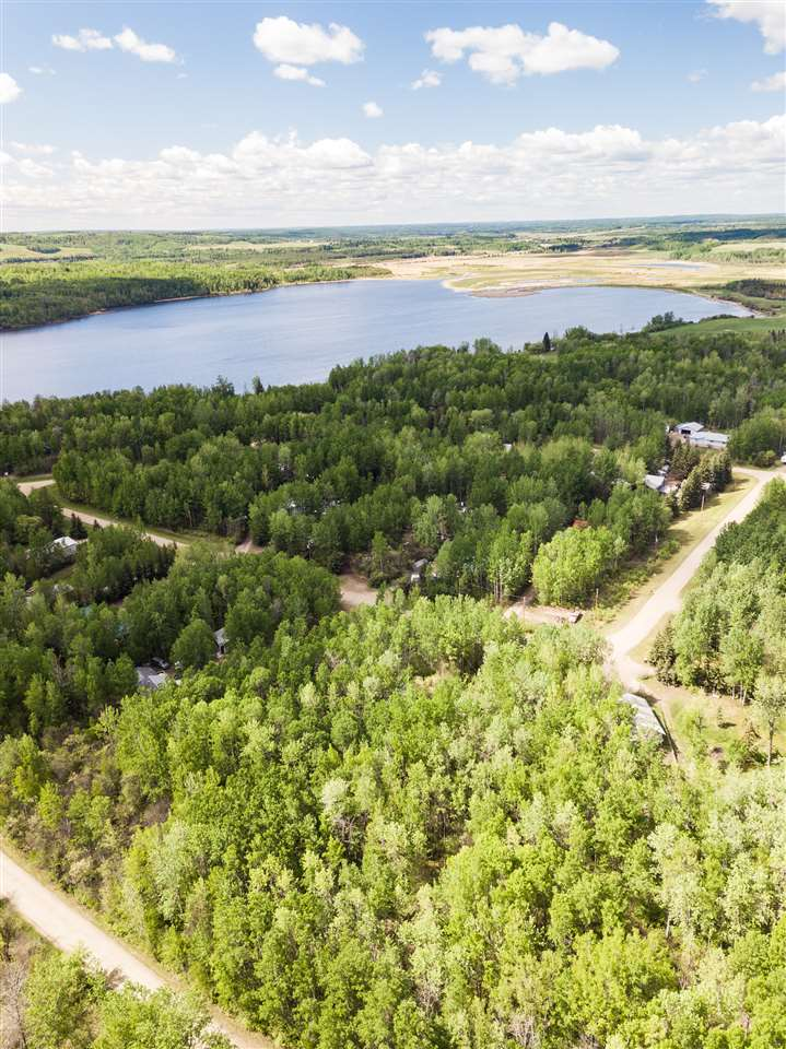 Welcome to 14 Woodland Bay Estates on Lake Isle! This 1.09 acre pie shaped lot is beautifully treed and private, and just steps to the lake! The subdivision is great for building your dream home or a weekend cottage with utilities to the lot line. A boat launch and dock are around the corner from you, bring out all your water toys! Only 5 minutes north of trans Canada highway 16, this lot is easy to find and is pavement up until the subdivision. Bring an offer and enjoy your summer at the lake!