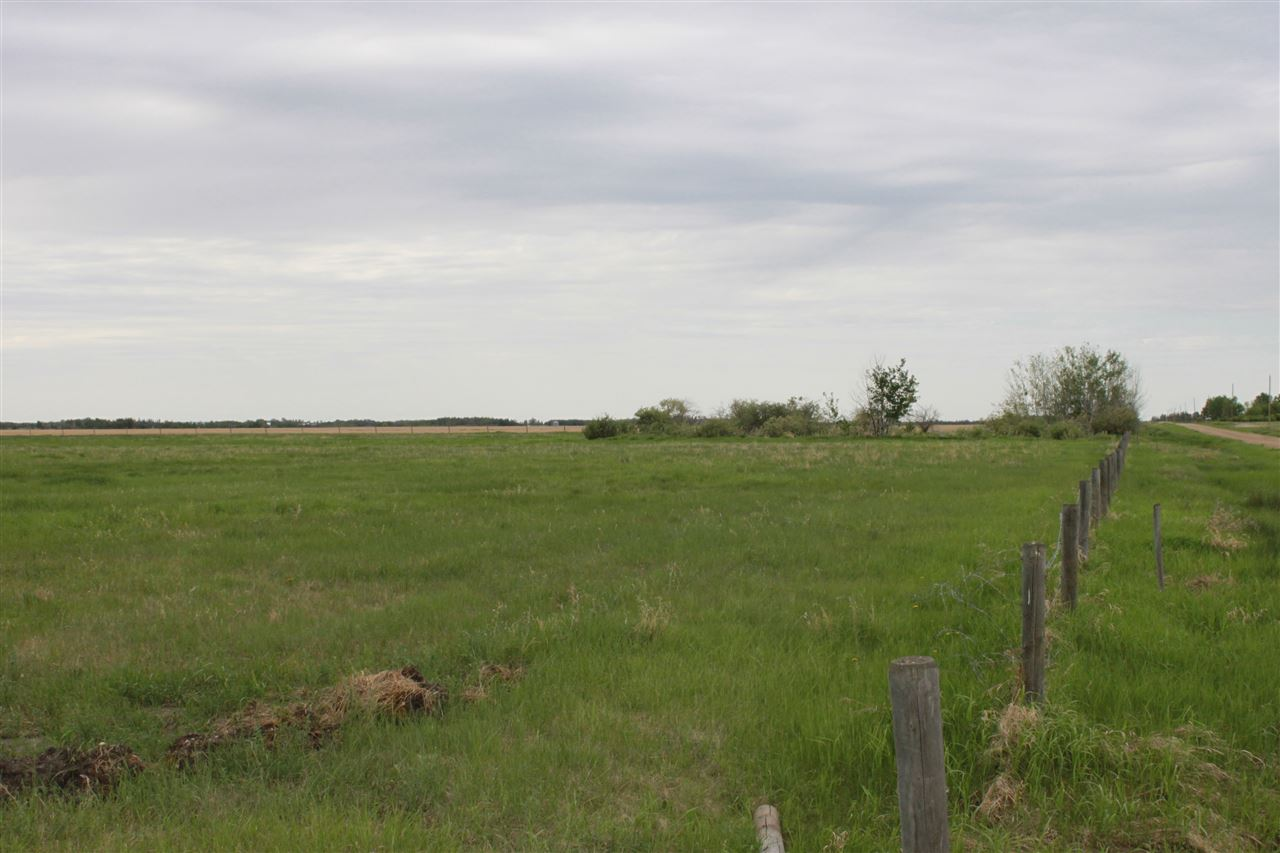 Great opportunity on a wonderful piece of land!  Only 35 minutes from Sherwood Park/South Edmonton, and 5 minutes from Tofield or Ryley, this 9.88 acre parcel is perfect for someone with the means to build and the desire to live a peaceful country life.  At only a shade over 1km from Highway 14, the commute offers almost minimal gravel road driving, ensuring an easier drive in the winter months.  Features of the land itself include existing fencing on 3 sides of the property, a nearly completely flat expanse to build on, and the option of open discharge septic.  Golfers should note that Coal Creek Golf Resort is just 5 minutes south, and outdoorsmen and women will be pleased to learn that Black Nugget Lake and campground sit just south of the course.  Welcome home!
