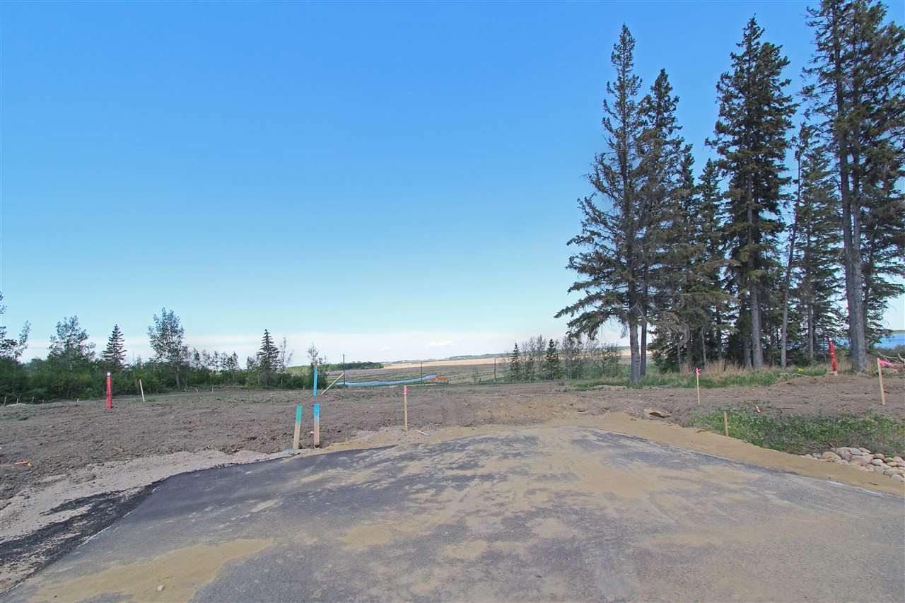 Lake Ridge Estates offers a rare chance to build your dream home on Big Lake, just steps away from the Lois Hole Centennial Provincial Park. The fully serviced, half-acre lots provide plenty of room for your estate home with the opportunity to build an outdoor oasis for you and your family to enjoy the surrounding beauty. Located minutes West of Edmonton and St. Albert with quick access to Highway 60, Highway 16, and the Anthony Henday. Only eleven lots are available for purchase with four backing onto Big Lake and Walkout options available. Don' t miss out on building your dream house in this architecturally controlled community. All lot are open to the public and GST may be applicable. Subject pie walkout lot is .50 of an acre and backs onto Big Lake.