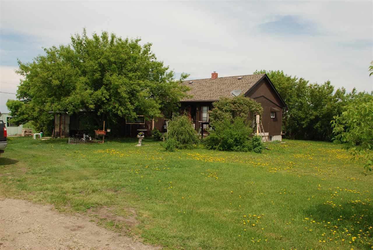 Great Retreat!!!  Lots of room for your enjoyment and to park extra vehicles.  4.82 acres with older upgraded home.  Several out buildings for storage.  Enjoy the peace & serenity with fruit trees, vegetable garden, and a dugout in rear.
