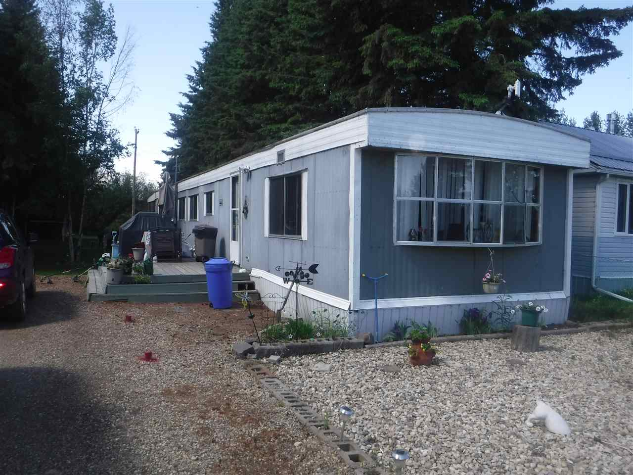 Looking for a Lake view? This quaint affordable home located across the street from the Lake in between both boat launches, offers you a great week-end get away or year round living. The 1978 14x68 mobile has 3 bedrooms and 1 4pc. bath with a 10x14 built on sun room at the rear with access from the master bedroom. Holding Tank is approximately between 650-750 gal. Nicely treed yard with fire pit, and you will never have rear neighbors as the land backs onto the creek.