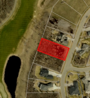 Prime treed lot in gated community backing world class Northern Bear golf course. Prime view of fairway and water body. City style services . Build your dream home with any builder you want!