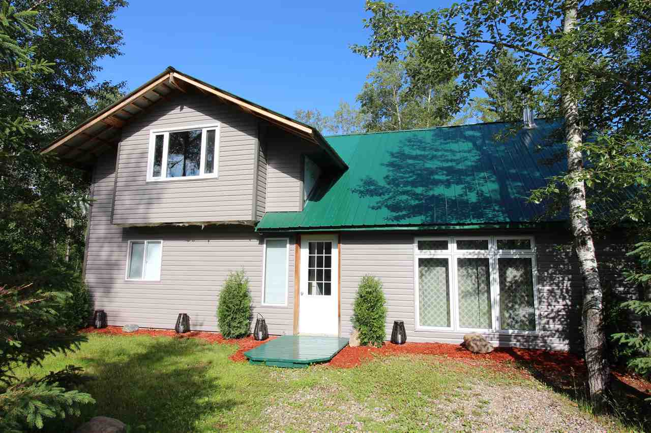 Opportunity alert! This is an exceptional property for someone wanting to live all year round at Moose Lake. This home features vaulted ceilings in the living room and dining room, wood burning stove, two bedrooms on the main floor with main bathroom and laundry room. The upstairs loft has a nook for a spare bedroom or den to read or relax in. The large room behind double glass doors provides great potential for a larger master suite or entertainment area so Seller is offering a $10,000 decorator's allowance for the remaining finishing touches. In addition to the main house, there is a separate A-frame building that serves as a guesthouse (or man cave). Plus, this corner lot features a walking path down to the shores of Moose Lake. Only a few minutes away from Bonnyville and in the subdivision of Birch Grove, make the move!