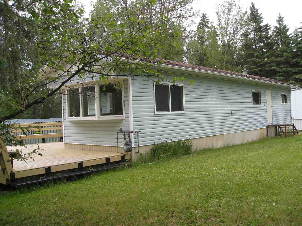 "The  2 Bdrm older 680 sq. Ft.  Single-Wide Mobile is located Lake Front at Lessard Lake. This nice and neat ""Cabin"" is perfect for those Weekend Getaways. Located on a Park Like setting, this 1 Acre parcel is looking for New Owners. Has several out buildings including a Sea Can for what ever you need to store. Just add Water and Septic and you could make this a Full-Time residence or leave it just as is . This property is very nice & Private nestled in amongst the trees. Has Power to the buildings also and Natural Gas to the Cabin. Come have a look and get your  Lake Front Cabin in the woods!!!"