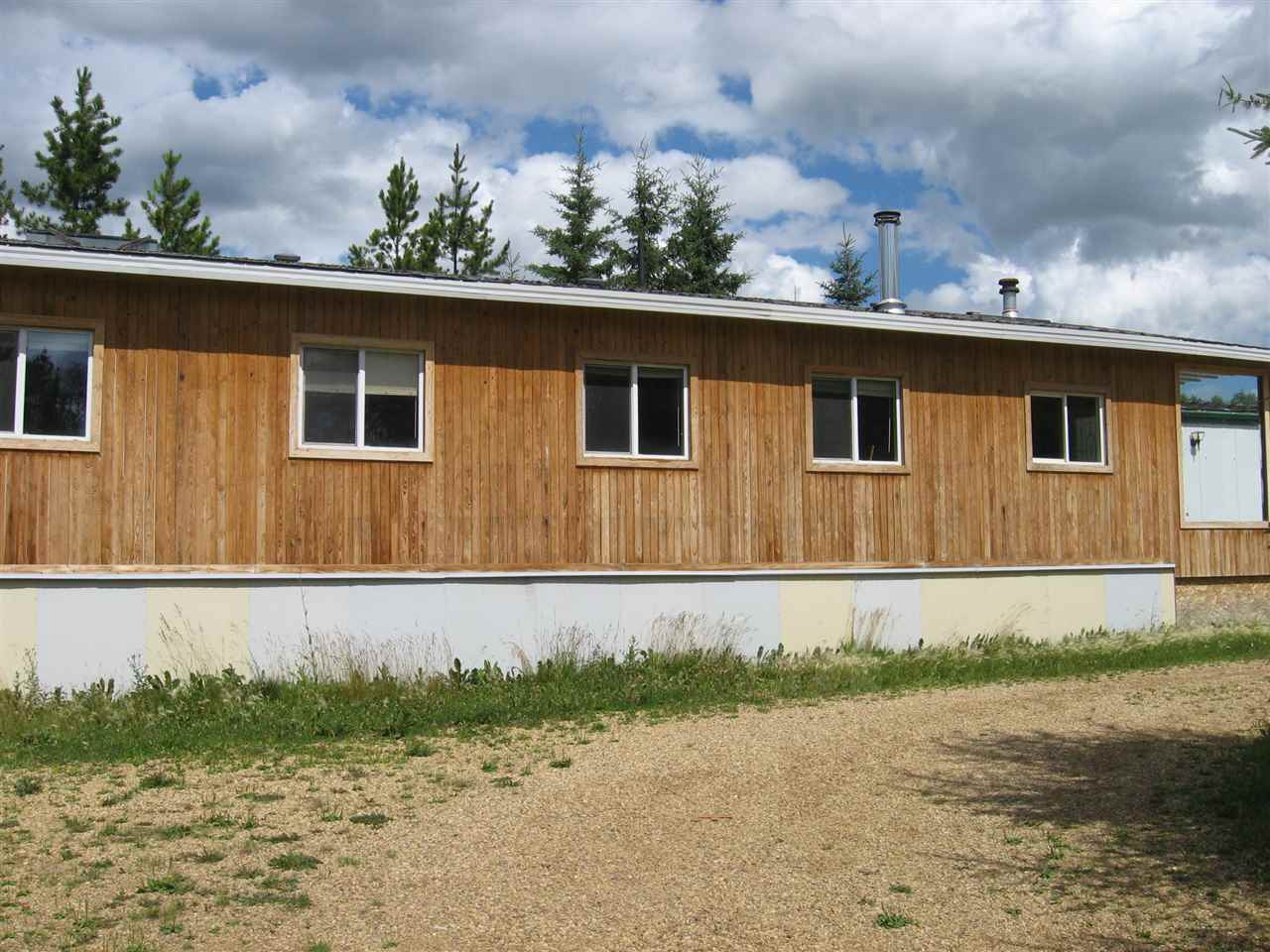Affordable Country Living, located in Beaver Creek Estates, 1982 mobile home with an addition with wood burning fireplace. other out buildings including older mobile home sheds must be seen to appreciate the possibilities of what can be done on this property.