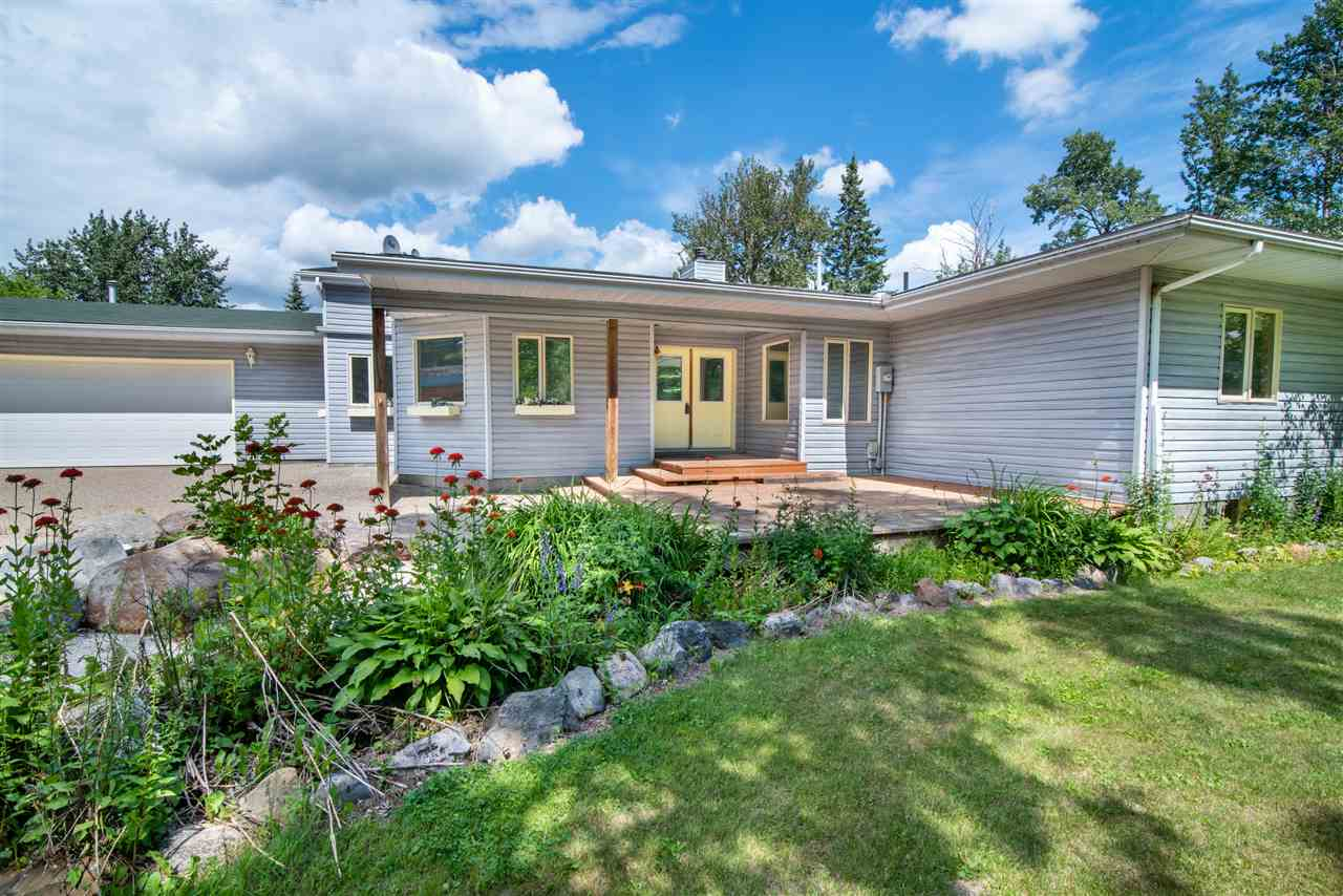 If it's space you're looking for, you'll love this 3479 Sq.Ft walk-out bungalow that sits on a 0.45 acre lot overlooking South Cooking Lake. You'll enter the home through welcoming double doors, greeted by a tiled entryway sided by two sunny den/office spaces. To the left you'll find a formal dining space connected to an eat-in kitchen with ample counter space, a huge walk-in pantry, & a 2pc bath, perfect for guests! The main living space is the center of it all, featuring grand vaulted ceilings, & a stone-surround (wood burning) fire place. From here, you'll venture to the sun room with a full view of the tiered deck & yard built for entertaining. This sun room connects to the master suite with walk-in closet, gas fireplace & 5pc ensuite. You'll also find 2 additional bedrooms on the main floor, a second 5pc bath, a & a full laundry room. Not enough? The basement boasts 2 more bedrooms, a 4pc bath, a wet bar, a kitchenette, additional living space & direct access to the yard. This layout is a home run!