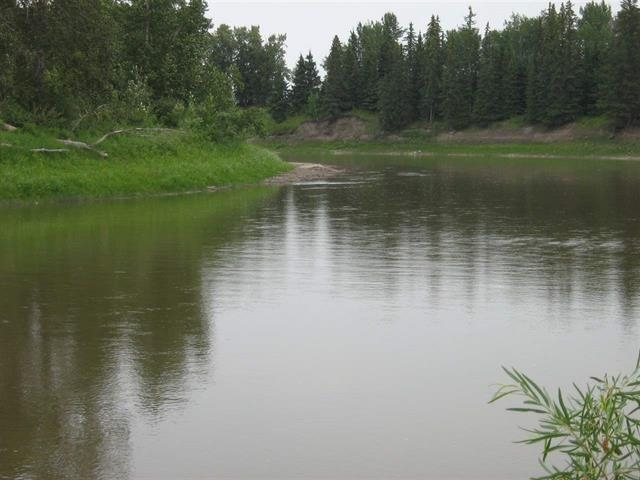PEMBINA RIVER FRONT PROPERTY - 35.04 Acres - with 1600' of River Frontage!! Great mix of trees and open land makes for very private location with room to play - Quad, Snowmobile or Rent 30 Acres for crop. Great location to raise a family or weekend get away. Great Recreation Property or build your Dream home overlooking the Pembina River.  Utilities are close. You will love this Country property with an Abundance of Wildlife and many activities available - Swim , Fish, Hunt, Canoe, and Kayak...just enjoy nature!!  Many amenities minutes away in Jarvie that offers Grocery / Liquor Store / Coffee - Lunch Stop, Community Hall, Seniors Drop-in Center, Church, Ball Diamonds, Campground and Playground. Also close to Long Lake Municipal Campground that offers ATV / Snowmobile Trails. This Property is Revenue Generating...Seller currently receives Lease...also Seller willing to Rent 30 Ac for Crop on year to year bases. Taxes ONLY $96/ year! Water Front Property Hard to Find...Do Not miss this Opportunity!!!