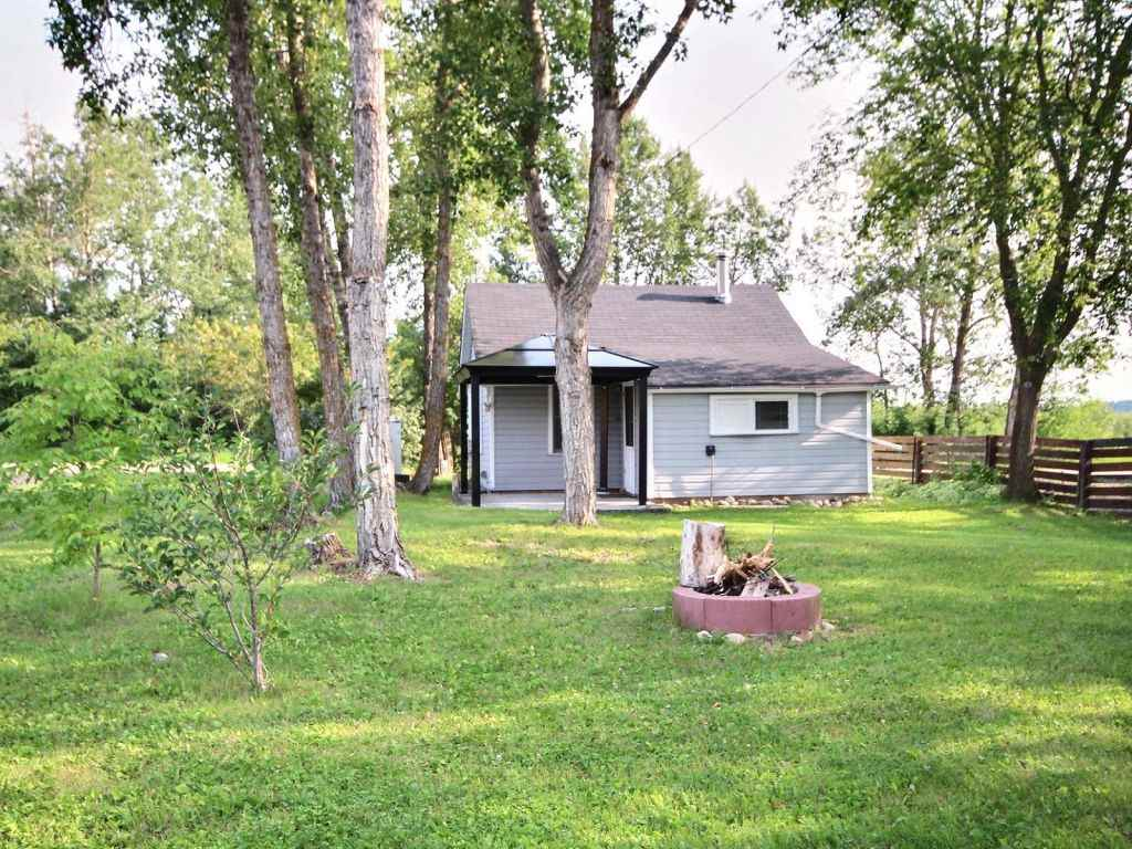 1 bedroom, with new kitchen including full size cooktop, convection microwave, fridge, and dishwasher. Full bath with front loader washing machine, dining area and living room, baseboard electric heat and wood-burning stove. Gazebo and level deck with Southwest exposure. Located lakeside in the hamlet of South Cooking Lake. Structurally sound, and in perfect repair. Large level lot, (approx. 50 x 150 feet) with new detached 2 car garage (24 x 24 feet) with openers and matching 8' x 12' garden shed. Connected to power and municipal sewer, natural gas available at lot boundary, water is trucked in as needed. 15 minutes to South Edmonton. 30 second stroll to South Cooking Lake Community Center and playground. The lake, large park and natural areas are right outside your front door, great hiking, nature observation and birding.