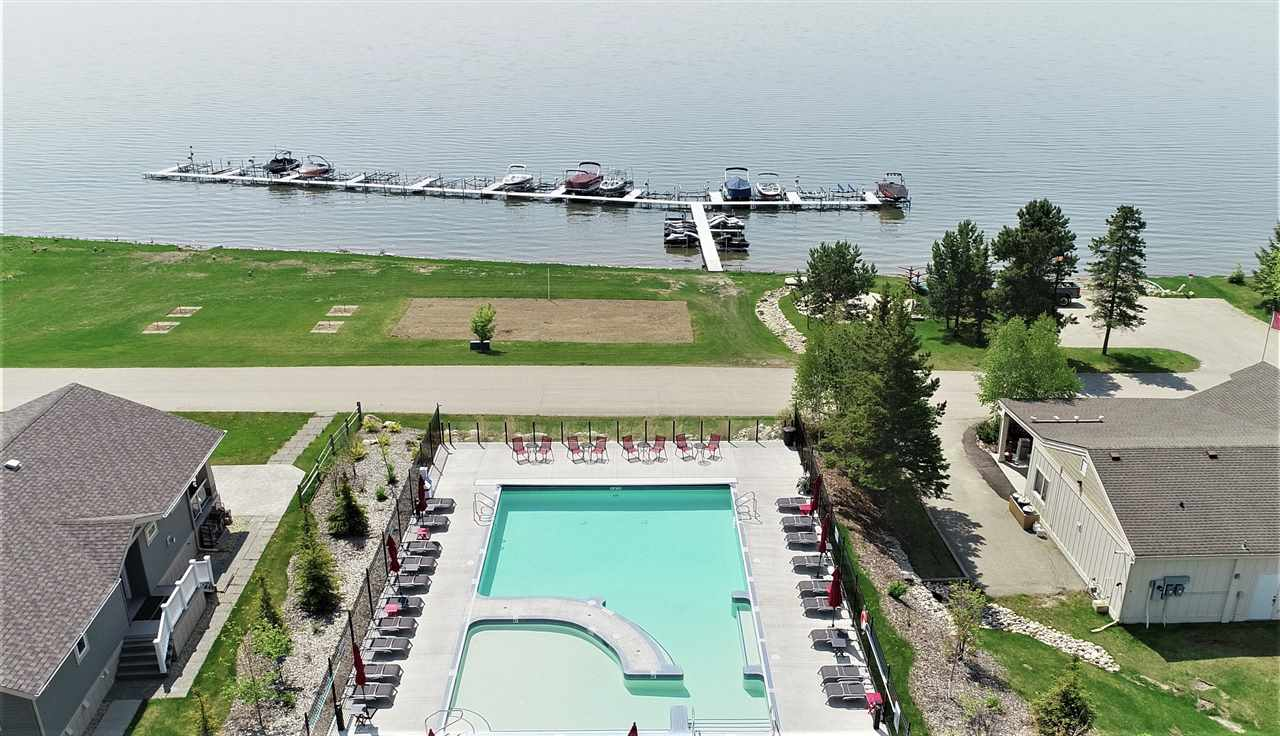 "SEASONAL SPECIAL PRICE plus GARAGE HEATED FOR FREE!!! POOL, MARINA, FITNESS CENTRE AND GATED!! The ""Willow"". Easy commute to the city! Very pleased to present this gorgeous Lake view lot. Price includes a Brand New 1268 Sq Ft Bungalow. HUGE Open concept kitchen with loads of cabinetry and a large peninsula that makes way to the living room that flows out to a large lake-front covered deck. The main floor is also host to the Master suite, powder room, 2nd bedroom and laundry room. If you want more space, the basement has room for a family room, 2 more bedrooms and an additional 4 piece bathroom. Located in a gated (not age restricted) community. Did I mention the Oversized attached garage. This community offers amenities such as a private marina, clubhouse, fitness centre, hiking, beach volleyball, and a gorgeous waterfront outdoor pool."