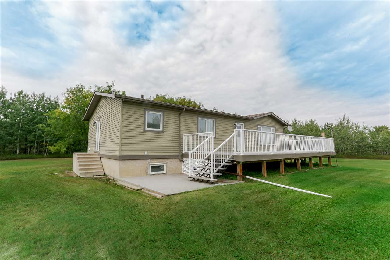 Amazing opportunity for your own country paradise! Situated on 5 acres, 30mins from Leduc & Edmonton, all on pavement, this 3+1 bdrm home has all the big ticket items already updated! Shingles, siding, insulation upgrade & deck in 2011. New septic tank in 2012, new hot water tank, pressure tank & furnace in 2013. Newer windows with lifetime warranty! Inside is an awesome country kitchen with tons of oak cabinets. Lovely large living room with hardwood floors & picture window. Down the hall is main 4pc bath & 3 bdrms, including master with double closets. Mudroom with front load W&D and 2pc bath. Downstairs is 4th bdrm & lots of space waiting for your personal touch.  Enjoy watching the wildlife while drinking your morning coffee on the low maintenance 14'x40' front deck. 26'x38' triple car garage provides ample space to store your toys & tinker away. Sounds perfect? How about an extra $2000/year from oil company that built access road on the very edge of your property- you don't even have to do anything!