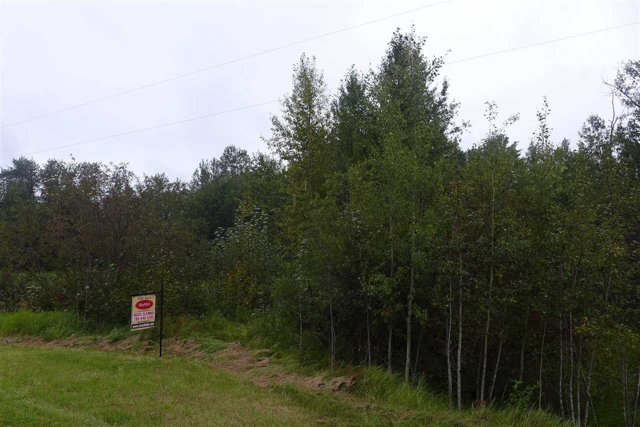 A SUPERB TREED PRIVATE 3.88 ACRE LOT WITH A FEW GREAT BUILDING SITES 30 MINUTES FROM SHERWOOD PARK IN WHISPERING HILLS ESTATES. Pavement all the way. The sub-division will remain of high quality with the building restrictions such as no mobiles or businesses operated on the property.