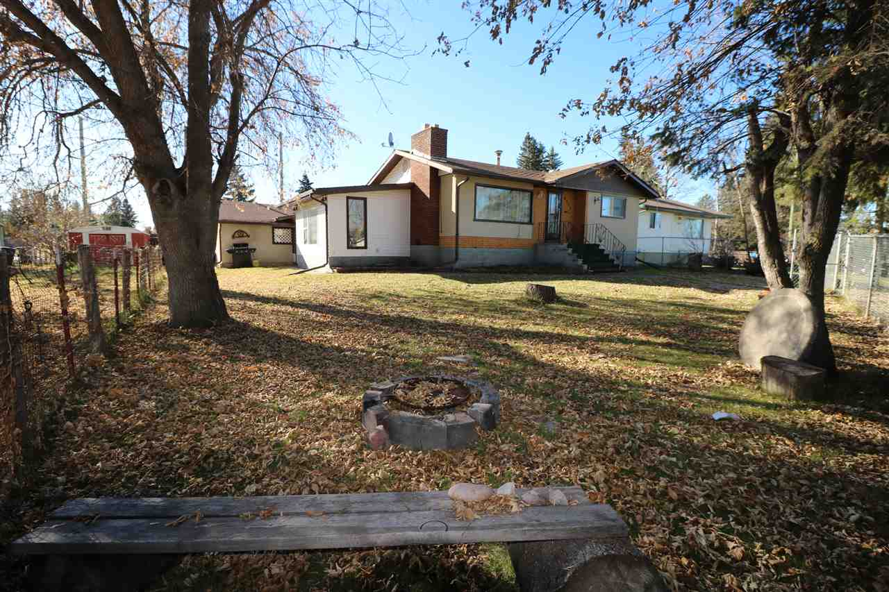 Great Bungalow close to the lake and on a full BASEMENT. This is a nice open plan with a living and family room on the main level. There is a wood burning fireplace in the living room and dinette overlooks the family room. There are 2 bedrooms and a 4 piece bath on the main floor and a partially finished 3rd and 4th bedroom downstairs along with the 2nd bathroom. The basement awaits your design and finish. The oversized single garage is the size of a double and is attached to the house with a completely closed in breezeway that make a great boot/freezer room! The yard is mostly chain link fenced and has front and rear access...wow!! Electrical has been upgraded to 100 amp service. The lot measures 72.5 x 111.95.