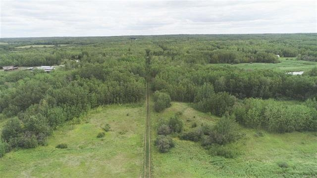 VERY SCENIC AND PRIVATE 46 ACRE PARCEL JUST 1 MILE NORTH OF THE YELLOWHEAD AND ONE MILE WEST OF ELK ISLAND PARK FEATURING A GOOD MIX OF HAYLAND AND TREES. THERE IS ALREADY A ROAD TO THE BACK OF THE PROPERTY TO AN ABANDONED WELL SITE. CURRENT REVENUE FROM THE WELL SITE IS $2500 PER YEAR.