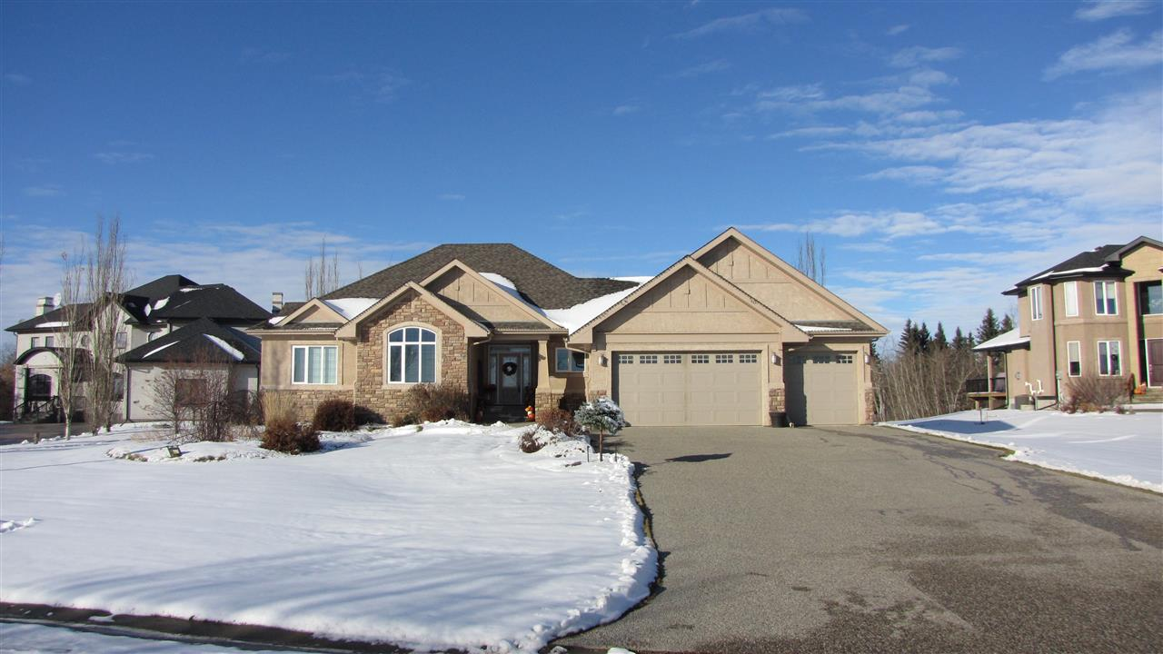 PRIDE OF OWNERSHIP is evident in this Fully Developed Country Residential 5 bedroom Custom Built Bungalow! Offering 2266 sqft + bsmt situated on a rare, massive .80-Acre lot in ALLIN RIDGE ESTATES, backing onto your own private park-like, beautifully landscaped yard! With 3+2 bedrms & 3 full baths. THIS HOME FEATURES 9 to 11-ft ceilings on main floor, 9-ft ceilings in bsmt, 4-zone in-floor heating up & down, granite countertops throughout, rich Maple hardwood, Massive dream kitchen boasts custom, timeless Maple Cabinets, lrg island incls raised breakfast bar, SS appliances, ceramic tile flooring, generous floor-to-ceiling windows, walk-thru pantry to/from garage. Master bdmr w/luxurious 5 piece deluxe en-suite. Laundry rm w/sink & maple cabinets. LOWER LEVEL BOASTS theatre/games rm, wet bar, 2 bdrm's & storage, hi-eff furnace & AC. Aggregate drive, huge 30'x14' deck, stucco & stone exterior, drive-thru triple-attached garage w/ Tandem bay~1138 sqft! Minutes to Edm & St Albert. JUST MOVE IN & ENJOY!