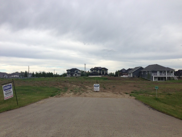 Gorgeous natural walkout lot perfect for a walkout basement with city water and sewer utilities along with, of course, gas and electrical (fully serviced lots) in Prestigious Park Lane Estates. Fantastic location only three minutes west on Yellowhead Trail, 16X Highway from the Anthony Henday intersection in West Edmonton. Surrounded by beautiful homes, this is one of the last lots to be developed in the subdivision. This lot is located away from the Yellowhead Highway so visual and noise etc are not an issue. Park Lane offers modern day convenience with nature at hand - walk to Big Lake - Lois Hole Park Reserve. Streets and access are fully paved with unique street lighting theme, Architectural Controls promote wealth. The perfect Lot to live, enjoy and invest. 105 foot wide lot allows all types of profiles of home and garages - rancher bungalows etc. If you want quality, this is excellent!!!