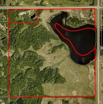 VERY SCENIC 127 ACRE PARCEL JUST MINUTES EAST OF EDMONTON FEATURE A MIX OF MATURE FOREST AND OPEN PASTURELAND OVERLOOKING A LARGE POND. THE PROPERTY FEATURES AN OLDER RENOVATED BUNGALOW, TRIPLE DETACHED GARAGE, 38 X 60 HEATED SHOP AND ANOTHER 40 X 100 HEATED SHOP C/W 3 OFFICES, BOARD ROOM, 3 PCE BATH AND RECEPTION AREA. BOTH SHOPS HAVE TWO 12' DOORS. ALSO INCLUDES A BARN AND A LARGE POLE BUILT SHELTER. THE PROPERTY IS DIRECTLY ACROSS FROM BELVEDERE GOLF AND COUNTRY CLUB AND BOASTS HWY 21 FRONTAGE.