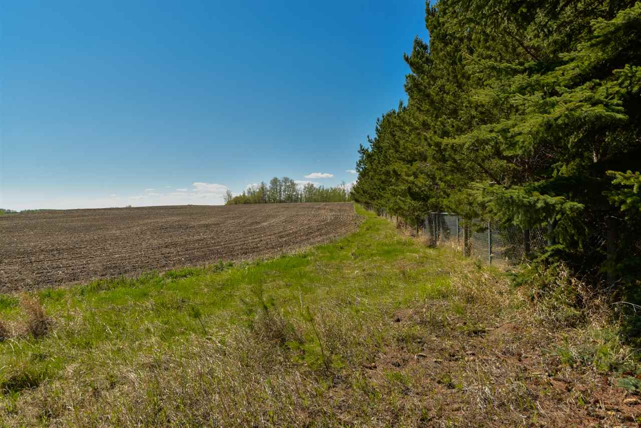 Excellent opportunity exists here for a savvy buyer or investor.  Nearly 63 acres are available on solid land with stunning views of the City of Edmonton on parts of this property.  Build your dream home OR subdivide to your heart?s content (property is zoned country residential and has been approved for future subdivision if desired).  Located on fully PAVED roads, within 10 mins to Spruce Grove.