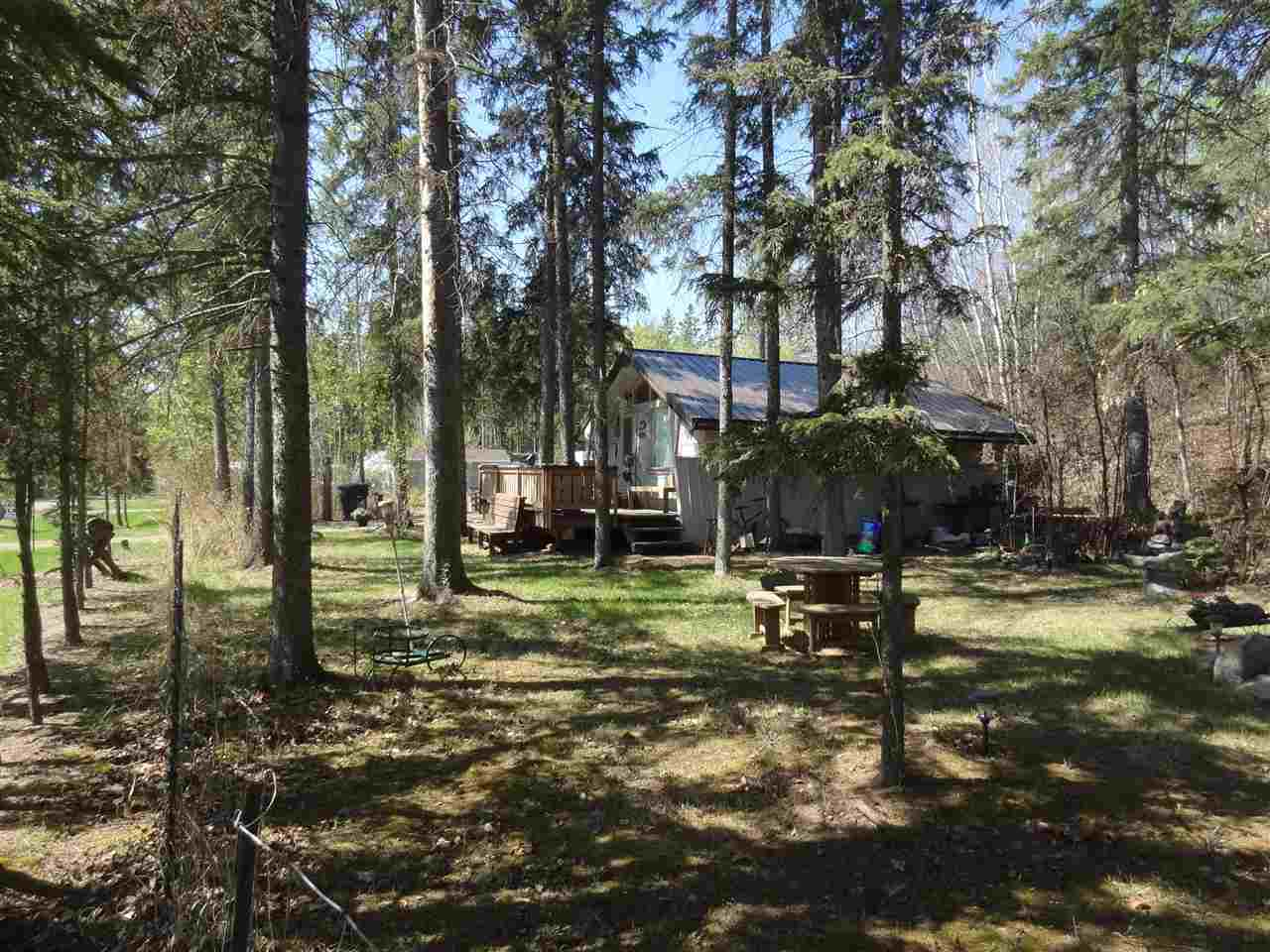"""Fully serviced cottage at Sunrise Beach on Sandy Beach - West of Morinville.  Cozy 1 bedroom cottage with separate guest/bunk house, storage shed, and shower house/ washroom.  One row back from lake - easy lake access a short walk away.  Gated and fenced with page wire. Just shy of .5 of an acre.  This was originally 3 - 60' x 120"""" lots which were combined into one title - potential to possibly convert back into 3. Can be used year round with the exception of water in the cabin (shower house/washroom can operate year round)  1800 gallon cistern and septic holding tank.  2 driveways allowing for ample access for weekend visitors. This affordable, peaceful retreat is the perfect place to make lifelong memories."""