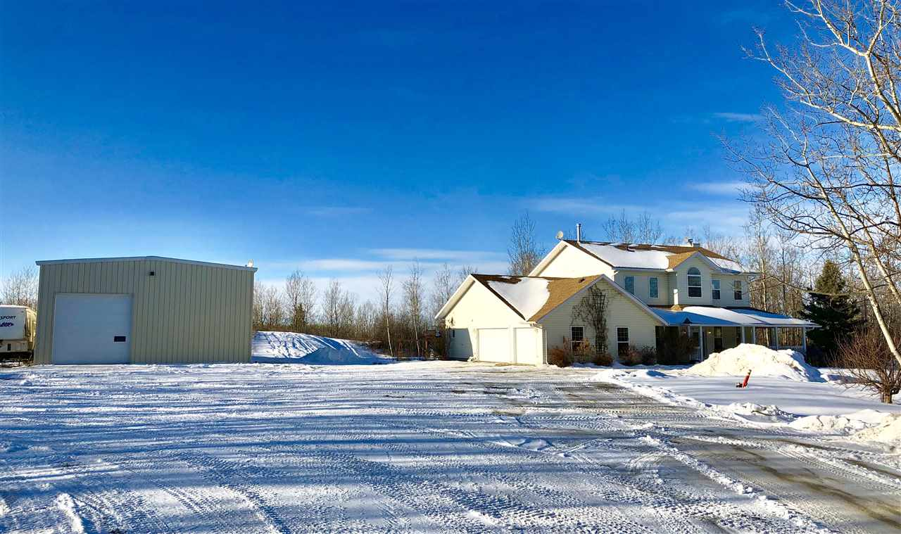 "Located only 10mins from Sherwood Park at RR210 just off the Yellowhead is this 20 acres of private OASIS just across from Elk Island Park. 3100+sq ft executive home is surrounded by nature featuring a pond, trials, trees, huge  yard, etc.has much to offer.Open concept main floor living space with an abundance of large bright NEW windows and includes a large living area with wood fireplace, dining nook, updated kitchen with granite counter tops and lots of cupboards.Mud/laundry room adjoining the 3pc bath.A formal dining room,bedroom(Flexroom) &2pc bath.Upstairs is the master suite with vaulted ceilings,reno'd spa like ensuite, 3 more spacious bdrms, bonus room and full bathroom.Infloor 5 zone boiler heating system and an iron eater. New shingles too. NEWER 40X60 steel framed insulated, powered SHOP with climate controlled radiant heating,engineered 6""concrete floor,20 ft ceilings,2-16 ft doors.Intricate stone walks, decked in hot tub,large patio & fire pit.105 ft well and pump-out septic."