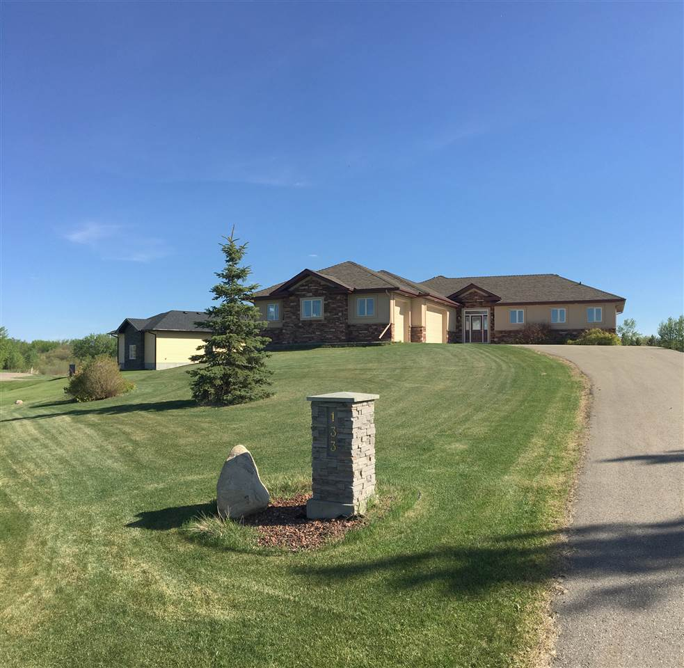 Built in 2007, this home is located in an exclusive community surrounded by other executive homes.  0.59 acres of easily maintained land surrounded by 40+ acres of habitat reserve.  Enjoy walking, cross country skiing, kayaking and skating right outside your door!
