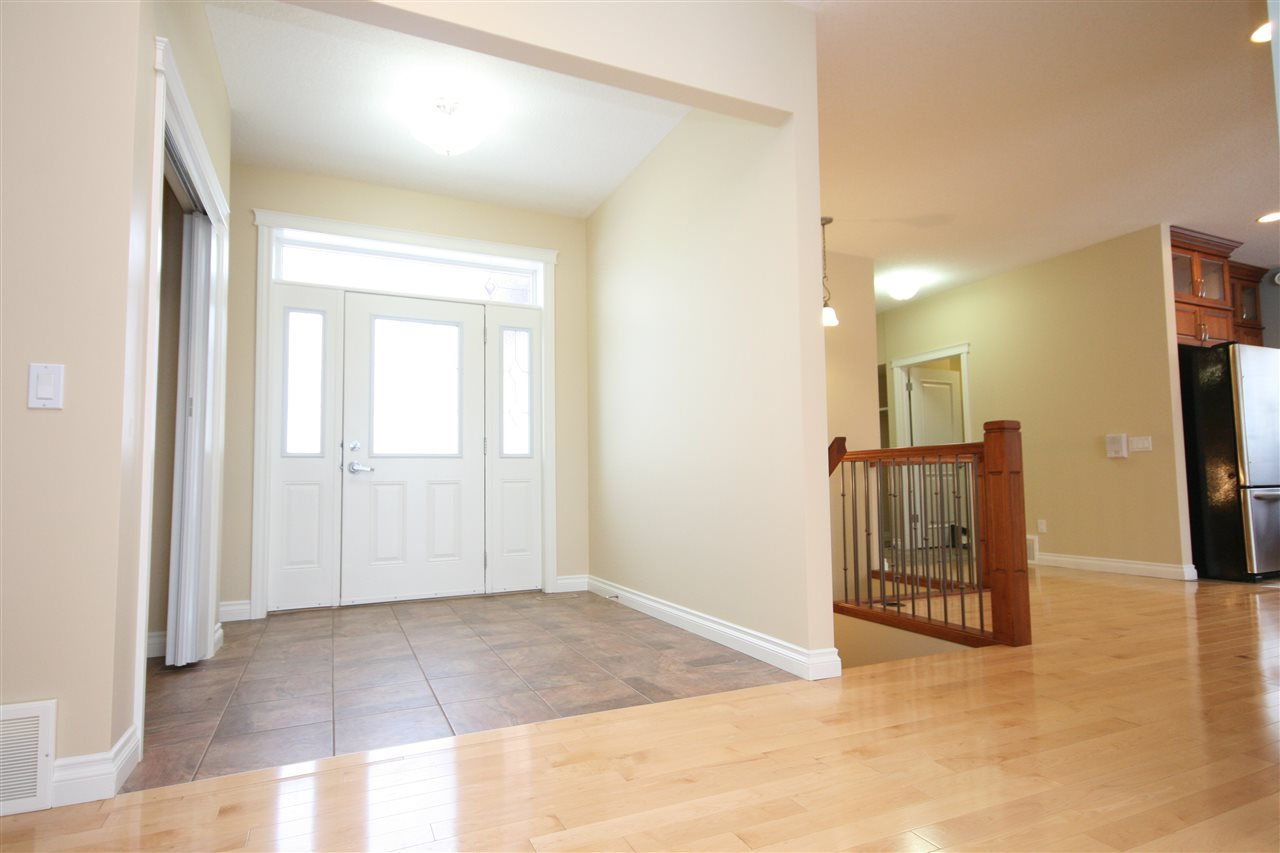 Spacious front entry with tiled floor and large coat closet.  The front door features a phantom screen and door with sidelights.