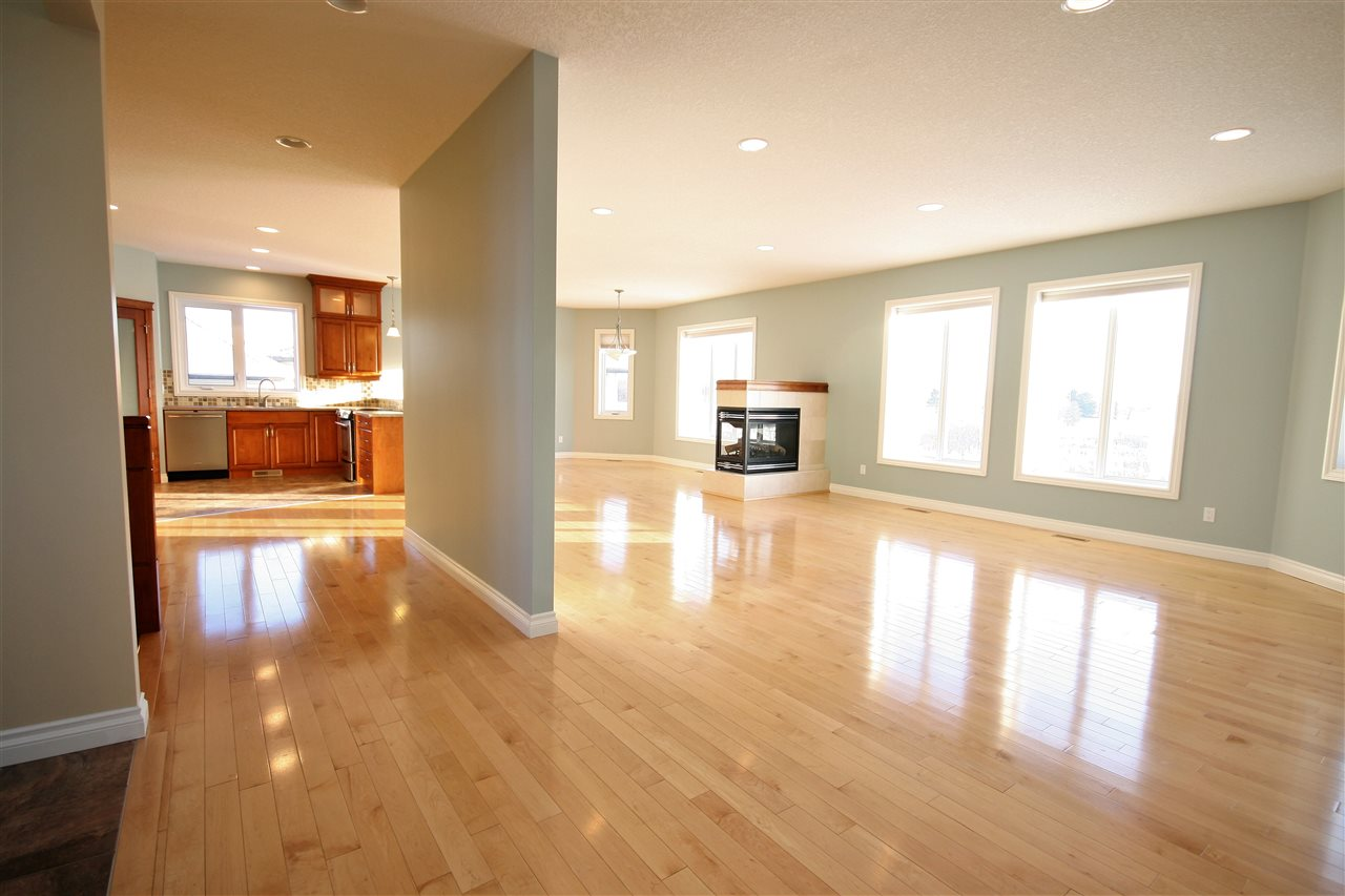 Light, maple hardwood floors and high-profile baseboards and trim extend through the main floor.