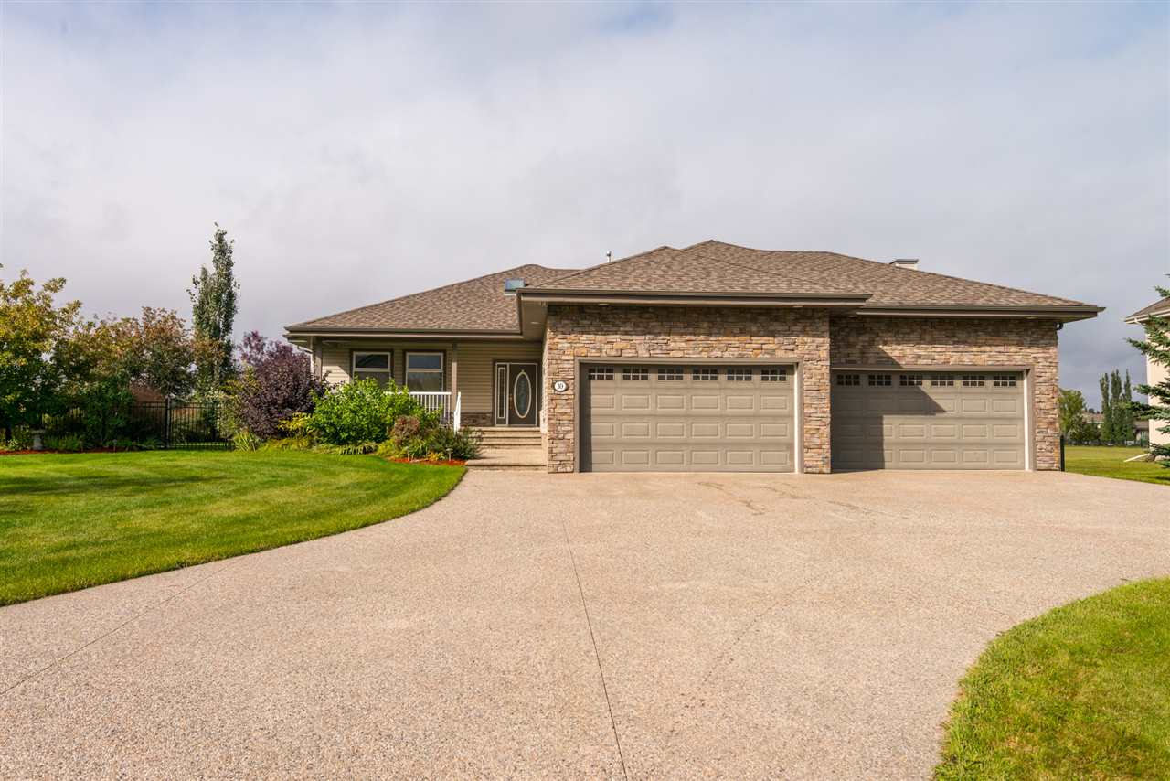 A prestigious 2145 sq.ft bungalow with a fully finished basement is yours to call home in Countryside Ravines, located 10km from Spruce Grove and 4.5km to the Anthony Henday. Details in every inch of the home makes the pride of ownership second to none. Dream to be greeted by a foyer boasting a natural skylight, pillars connecting to the family room and enormous kitchen, eating nook and formal dining area. The main floor also features a large master bedroom, walk in closet with custom shelving, an ensuite and private balcony to slip away for morning coffee. The remainder of the main level hosts a large office, laundry room, and separate entrance from your quad size garage fit for all of your favourite machines. The basement is complete with three more bedrooms, an entertaining area with a wet bar and best of all, a theatre room. Above and beyond cosmetic details, the home is heated by a high efficiency IPL Boiler System which generates heat for 4 zones ensuring you are always comfortable.