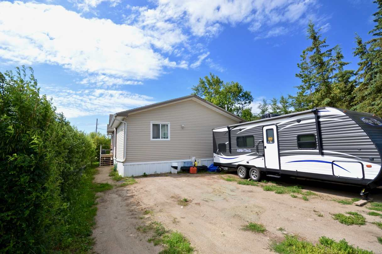 This 4yr old, open concept, 3 bedroom/2 bath modular home is equipped with every upgrade except the granite.  It includes garden doors in the dining room, walk in shower in the main bath, wood truss flooring, framed/insulated skirting and double bolted trusses.  All bedrooms are generous in size and have walk-in closets. The 2000 Gallon septic was newly installed, the well redone to bring in the fresh clear oror free water, newly buried power and gas lines and a water softener system.  Appliances, all 4yrs old, include the fridge, gas range, built in microwave and dishwasher, washer and dryer.  An additional gas line is installed for the BBQ.  All located in Seba Beach which is an hour west of Edmonton to one of Alberta's best lakes (Wabamun).  Seba offers plenty included but not limited to school, small store, postal services, sailing clubs, golf, restaurant, tennis courts, driving range, the list goes on and on!