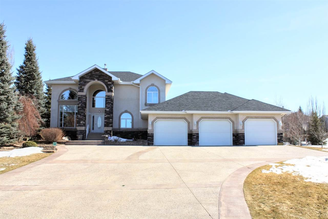Over 2900 sq ft two storey plus fully fin. basement situated on almost 3/4 acre lot in Lakeshore Estates, one of the largest lots in the subdivision.  Located just 5 min. west of Edmonton & St. Albert on CITY WATER AND SEWER!  Recent upgrades include: new boiler, hot water on demand system, shingles (2017), deck & accent ext. stonework.  Main entrance opens up to an impressive curved stairway & 20' ceilings.  There is a formal dining room, office & a main floor laundry.  The kitchen features granite counters, high end cabinetry and an island counter.  The family room offers a cathedral ceiling & gas f/p.  Kitchen nook area overlooks huge fenced backyard with low maint. decking with included $4000 gazebo.  Yard has mature trees and irrig. system.  The upper level features 3 bedrooms, all with walk-in closets.  The master has a spa-like ensuite with jacuzzi tub.  Prof. fin. lower level has 2 more bedrooms, rec room with wet bar & in floor heating.  Heated 35' wide triple garage!  Like new home, must see!