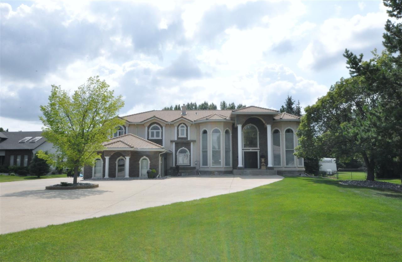Fully renovated luxury estate home only mins from St Albert. With over 7000 sq ft of living space incl professionally finished bsmt, this home was designed to impress. Soaring 2 storey entrance w/grand chandeliers highlight the curved open rise staircase. Spectacular kitchen w/beautiful granite & high end SS appliances, more custom cabinets than you could ever dream about, 2 huge islands & an adjoining breakfast nook. Main flr is complete w/magnificent great rm w/vaulted ceiling, gleaming hdwd flrs & massive fireplace, formal living rm, dining rm w/2-storey bay window & an office. Upstairs features a spacious master suite w/opulent ensuite & walk in closets, 3 more sizeable bdrms & 5 pc bath. The lower level has a large rec rm, games rm, den, 5 pc bath, 5th bdrm & superb fitness rm. This home has enough space for even the largest of families, 2 central A/C units & heated triple car garage. The backyard is a one acre entertainer's paradise to enjoy the sunny southern exposure on the wide open patio.
