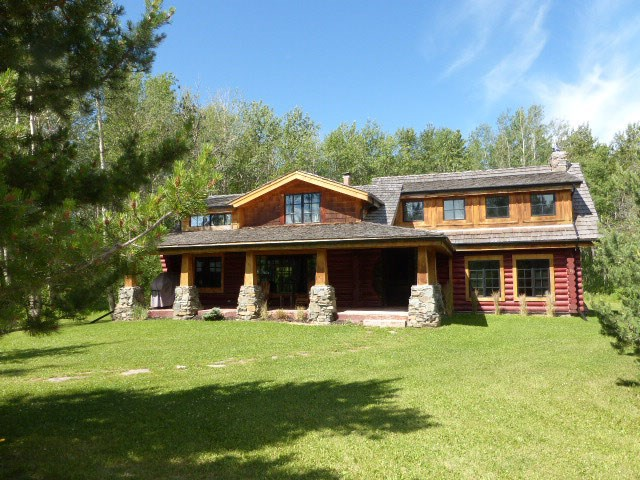 Gorgeous 1 ½ storey log home is located at Poplar Bay at Pigeon Lake & surrounded by beautiful mature trees. Large covered front veranda. Main floor family room with H/W flooring, W/B F/P with slate facing & garden door to back deck. The beautiful H/Q extends into the LR which also features a cozy W/B F/P with stone facing. Spacious adjacent DR features large window. 4 pce bathroom & main floor washer & dryer. Open kitchen with countertop gas stove, BI oven, window over sink, wine rack, & peninsula separates kitchen from the living room. Open beam. There are 2 separate staircases. One goes to three secondary bedrooms & the other goes to the master bedroom with hardwood flooring & 4 pce ens with stone floor & is open to the family room below. Furnishings stay. New HWT & furnace. New cedar - grade A roof & hot tub. Lovely mature landscaping. Det garage. This property has access to the lake. Lot 2 features a separate bunk house is $668.51 sq. ft. has power & access to water, gas & sewer.