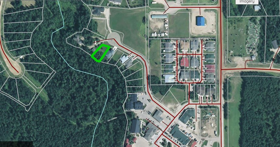 Beautiful lot backing onto ravine within easy walking distance to Pigeon Lake, the Village at Pigeon Lake, golf courses, walking paths and nature at its finest.  Sewer line has been brought onto the property with balance of services at the property line.  Great opportunity to escape from the hustle & bustle of city life and build your dream home.