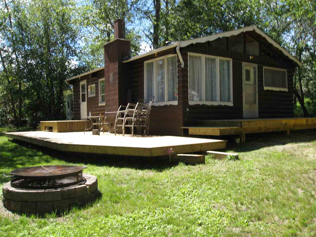 This 3 bedroom partially serviced cottage just needs the natural gas to be added then all the services would be ready to go from April to October. Has a 500 gallon cistern and a 750 gallon holding tank. This home has the original hardwood flooring and log siding to keep the rustic look for this 3 season cottage. Comes with an additional lot beside it which is also included. There are 2 Lawn Mowers and Patio Furniture which will be included in the price.This is a very private recreational property and is looking for new owners!!