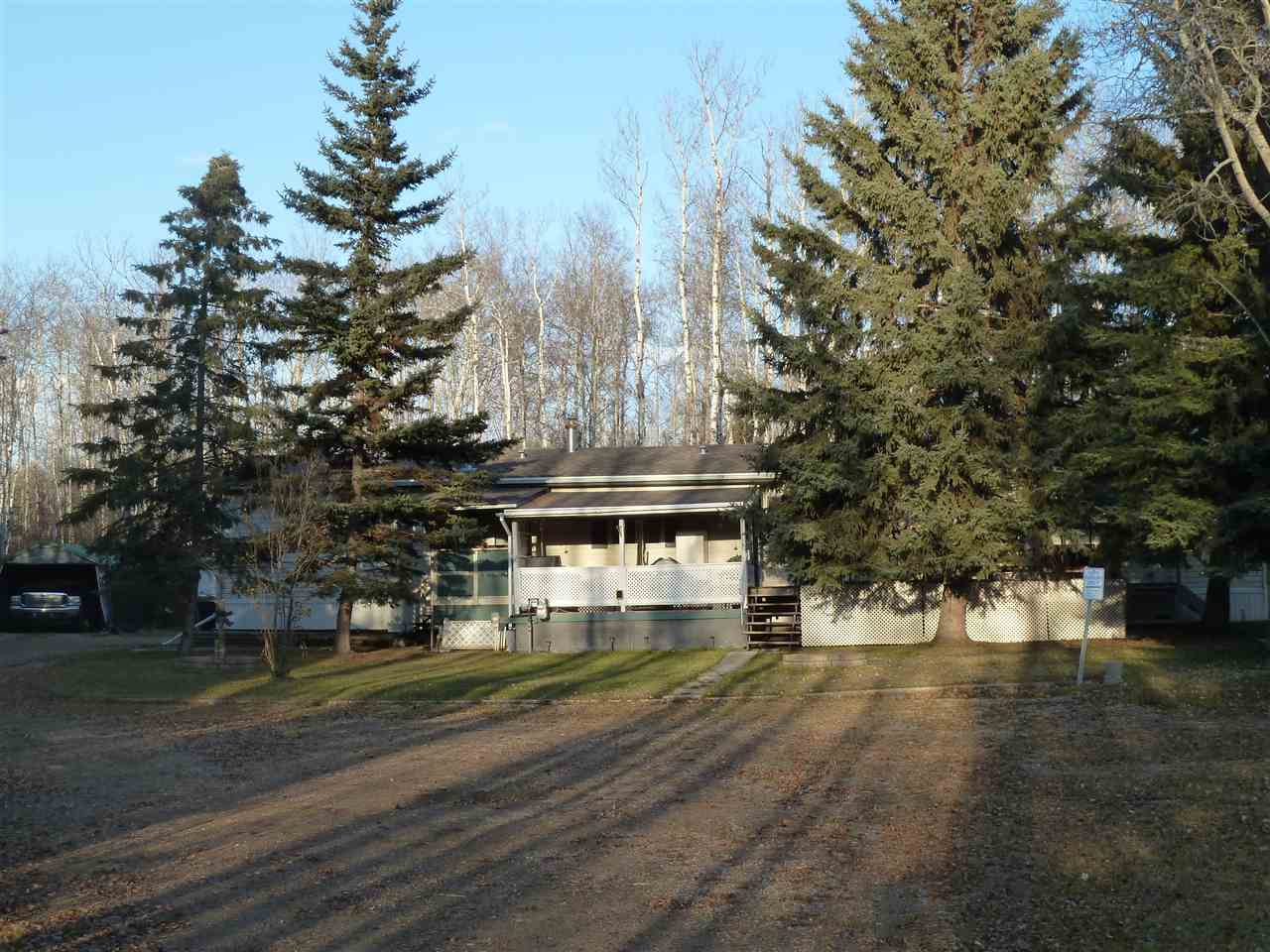 This year round home or summer retreat  is a steal of a deal at Fork Lake Estates!  This great property is situated in a quiet cul-de-sac and has a 16'x76' mobile with 3 bedrooms, 2 bathrooms, one being an ensuite off the master with a jetted tub.  In addition there is a 12'x16' guest cabin with power and an antique wood, coal/heat and cook stove. This .65 acre property and mobile has been well kept over the years, is nicely landscaped and offers a large variety of powered sheds and a wood shed and a nice deck.  There's also fresh berries and cherries and a great firefit area with a gazebo. Gorgeous sandy beach nearby.  You'll be very pleased when you view this lovely home!