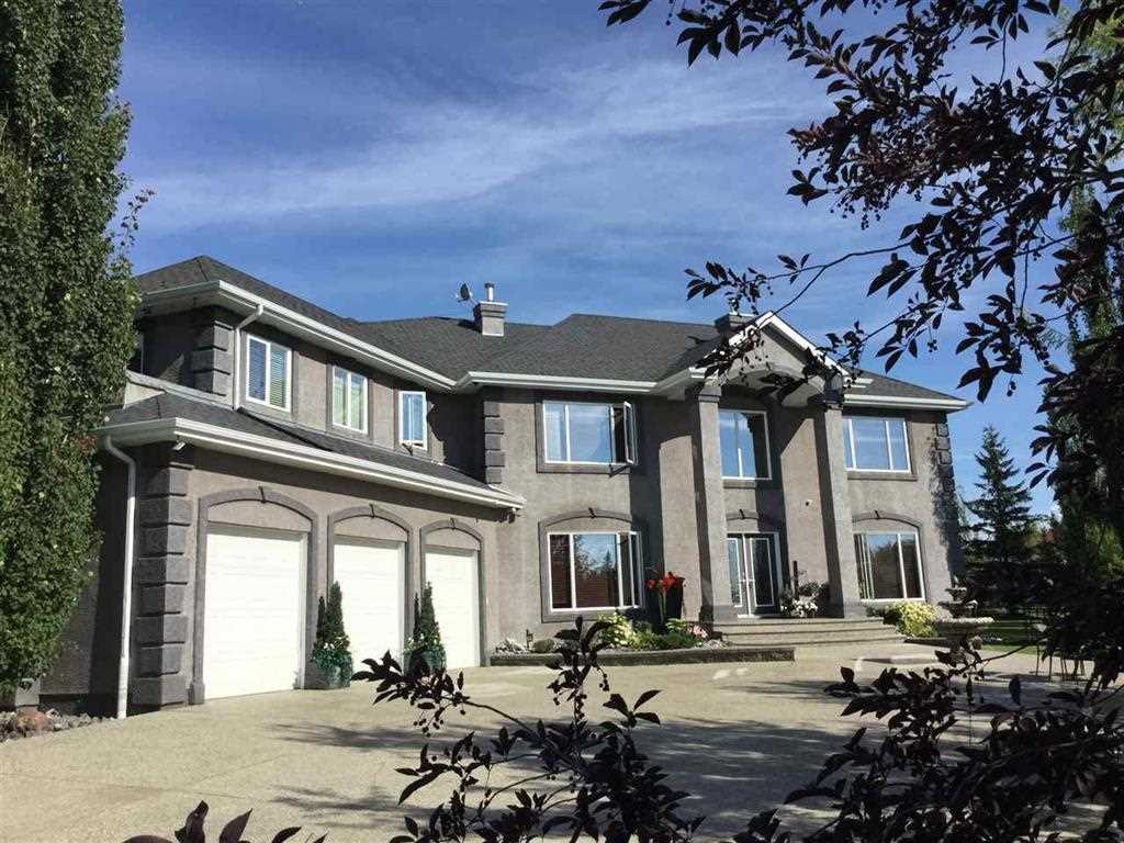This exquisite home is priced to sell with motivated sellers! BRING YOUR OFFER! One of the most beautiful family homes in prestigious Lakeshore Estates! Located just minutes west of Edmonton. Offering peaceful country living with all the city conveniences such as water/sewer, new community playground, and school bus service. Features new central air (2018), refinished cherry wood floors, dramatic box vault ceilings, stainless steel appliances, finished basement (easily able to accommodate additional bedrooms). Over-sized triple heated garage, new shingles (2017), expansive aggregate driveway with RV parking. Beautiful backyard with irrigation system, deck, fire pit, hot tub with gazebo, and removable pool. Fantastic visual appeal from every angle inside and out. All furniture and contents negotiable.