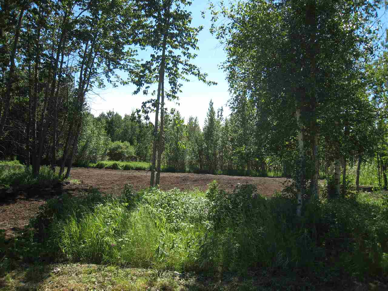 Ready to build your dream home on this almost 3 acre plot? (There are 3 to choose from). It is only 3 miles (5 kms) to Westlock. MUNICIPAL WATER, Natural gas and Power ARE ALL AT THE DRIVEWAY and you just bring it onto your lot where you want your home! This acreage is big enough for animals (barn), a shop, and plenty of kids!! Trees are scattered throughout to offer privacy and pleasure!! A machine has mulched and created clearings among the trees but the Sellers will clear more at no cost if desired. There are architectural controls in place. There is also Lot 7 which is over 18 acres and beautifully treed (make an offer).  The photos are  various ones of the lots that are for sale.. GST applies.