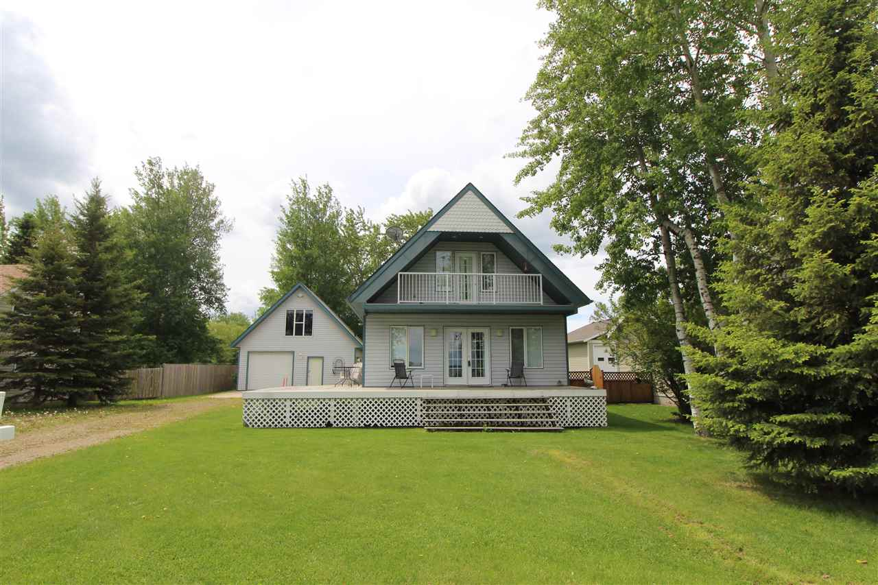 The beautiful Summer Village of Poplar Bay welcomes you!!  This home is located a stones throw away from the shoreline of Pigeon Lake.  Sitting on your front deck you have a gorgeous unobstructed view of the stunning lake.  Built in 2003 this country cabin has 3 bedrooms and 2 baths, laundry, open kitchen/dining/living room area, skylights and fireplace.  Plenty of room for storage in the full loft space above your oversized single garage.  Outdoor shower, fire pit area, back deck and an endless south facing open green space.  Plenty of room for the whole family to make some amazing memories!!