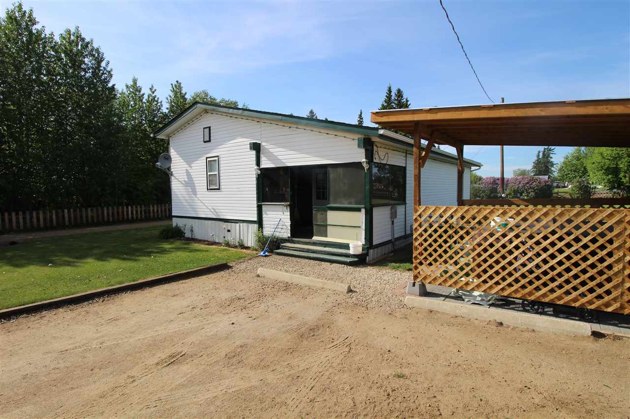 Great little starter acreage, 9.7 acres that is very well looked after and maintained. 1991 16x56 Shelter mobile home with a 12 x 30 addition for 1250 sqft of living space. The home has newer shingles in 2011, newer furnace in 2012, windows done in 2015, new hot water tank in 2018, woodstove in second family room, 2 bedrooms and a 4pc bath. Newer laminate flooring and lino in home. Outside you will find a new covered hot tub (2018) numerous outbuildings including a 40 x 60 Quonset. Entire acreage is fenced. Numerous trees, fruit trees and shrubs, very large garden area. All this and still room for all your family and friends to bring there RV's and enjoy some peace and quiet.