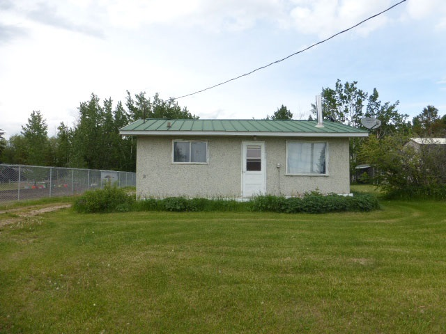 Cozy  529 sq. ft.  bungalow located on pavement at St. Francis on a huge one acre lot.  Two bedrooms, 4 piece bathroom, kitchen and living room with wood burning stove (stays).  Fenced two sides.  Mature fruit trees & lilacs.  Garden area.  Services include power, drilled well, septic tank.   Great starter home!