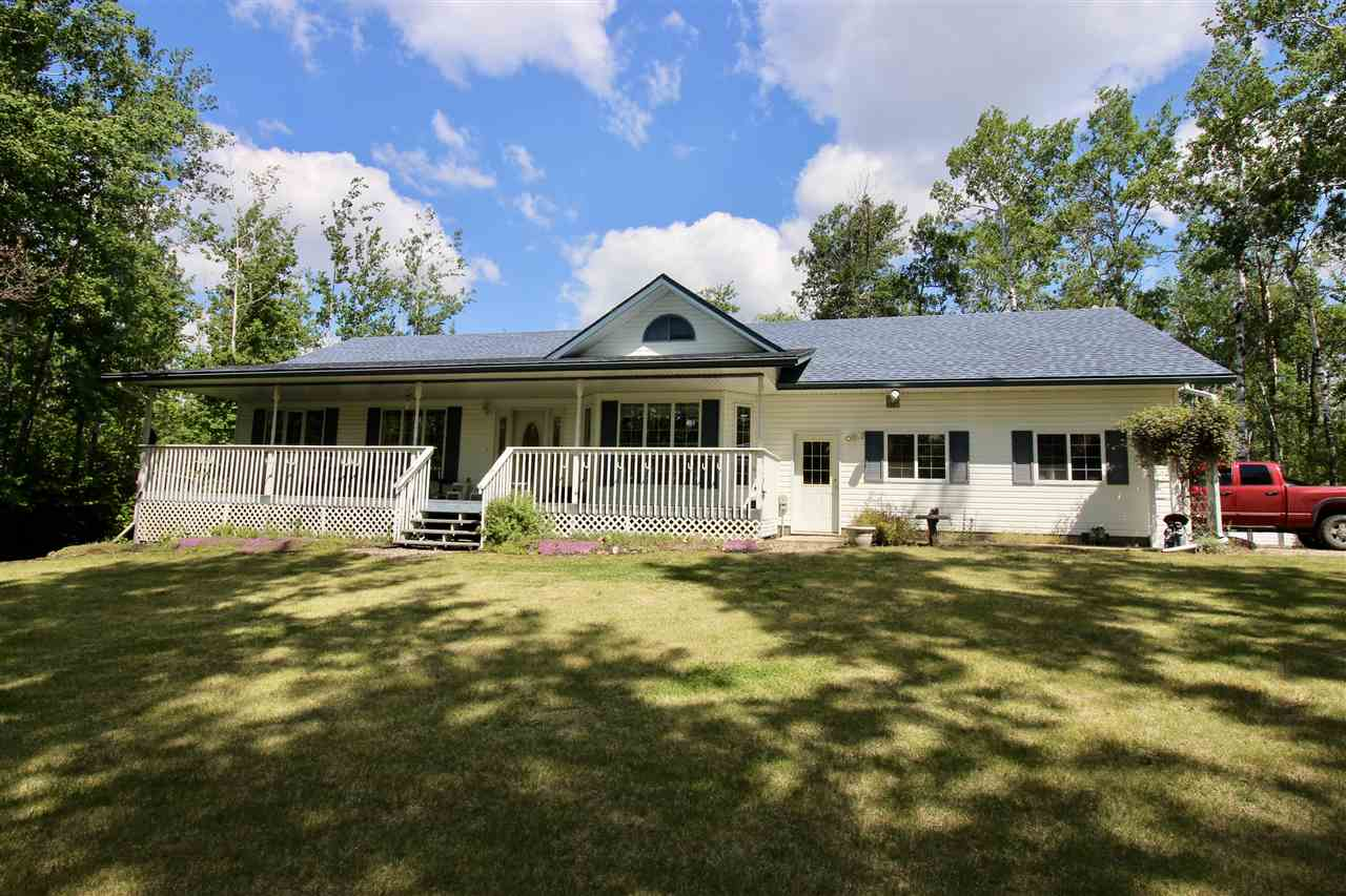Custom built bungalow is located on an extremely private and secluded acreage that is only a stone?s throw from public access to Moose Lake. The open design creates spaciousness and lends itself to entertaining and family gatherings. The kitchen is the heart of this home. Featuring a walk thru pantry, sizable 2-tiered island and plenty of room in the dining area. Living room boasts vaulted ceilings and a gas fireplace. Main floor laundry, large master bedroom and a spacious 4 pce bathroom. Basement is fully developed and features a 3rd bedroom, 3 pce bath and an extra-large family/rec room. An oversized 2 car attached garage is heated and is also has a designated workshop area for a multitude of uses. Location, location location?this one screams it out!