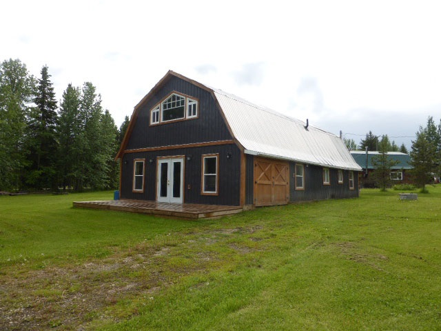 This barn conversion into a residence is located on a .52 acre lot at Buck Lake.  1964 sq. ft. two storey has the upper level completely developed. Features a large master bedroom, three piece bathroom with shower.  Good sized kitchen with centre island, stainless steel appliances, skylight and the living room has a corner fireplace and door which leads to the upper balcony.  The main level has pine interior and could be developed into more living space.  Year built is 1969.  Services include 2000 gallon septic tank, power, gas, cistern (1100 gallons).  Nicely treed yard.