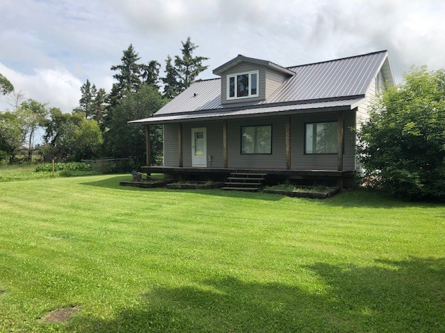 So loved & cared for & so much to offer: ONLY 11 KMS TO WESTLOCK - 3.51 acres w/tons of grass, water bowl, good well, & 28'x30' dog run/kennel. 1450 sq.ft. house has huge country kitchen, big Liv/Rm, sweet bathroom w/clawfoot tub from Tubs of Distinction Florida, main flr laundry (plus set in bsmt), 2 bdrms + flex rm up, den/playrm in bsmt.  Bsmt bath ready to finish - toilet in, sink there & space for shower- add walls & good to go... Features: 2001/'02 Fencing all inside prop line, shingled & added grade beam in garage & furnace in '04. 2004/05 -new: house furnace, flooring L/Rm & Mstr, grade beam in Liv/Rm, upper level - added dormer/window & tons of insulation, new metal roof. 2008/09-reno back entry, added sink & stack washer/dryer, bath reno with gorgeous tub & custom window, added deck across front, roof & overhang. 2010- water softener. 2011 Pole shed 30x50. 2014-17- drywall entire upper flr, new well pump, pressure tank, windows upper, new concrete septic tank, etc!! Shop 28'x25'+28'x10' lean-to.