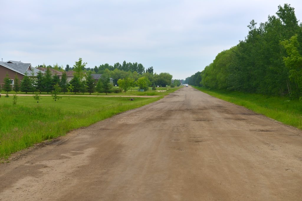 1.38 acres, just 2 miles from Westlock. Land is level and ready for your new Home.  Just a short walk to the Golf Course.  Upscale subdivision with numerous upscale Homes.