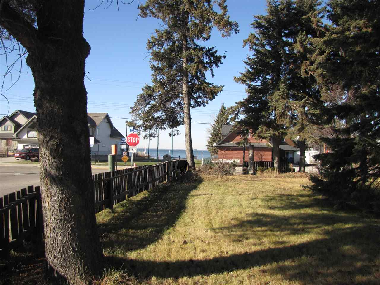 Large corner lot in Alberta Beach,with lake views from the property. Double lot is across the street from lakefront park and has many mature trees. Centrally located close to grocery, shopping, restaurants and golf course and boat launch. Property has an existing drilled well, hook up to municipal sewer, and natural gas ,power, telephone are at property line. Lot frontage faces south and west on 47 Street and 50 Avenue.